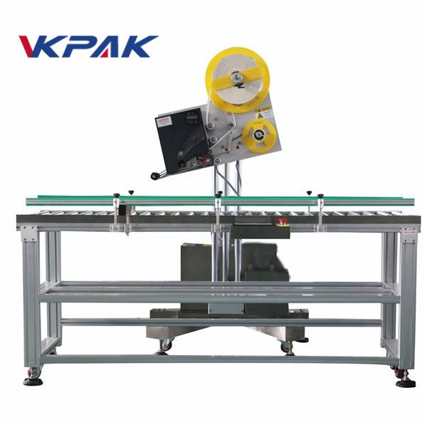 Stroj za samodejno označevanje zgornjih plošč za steklenice
