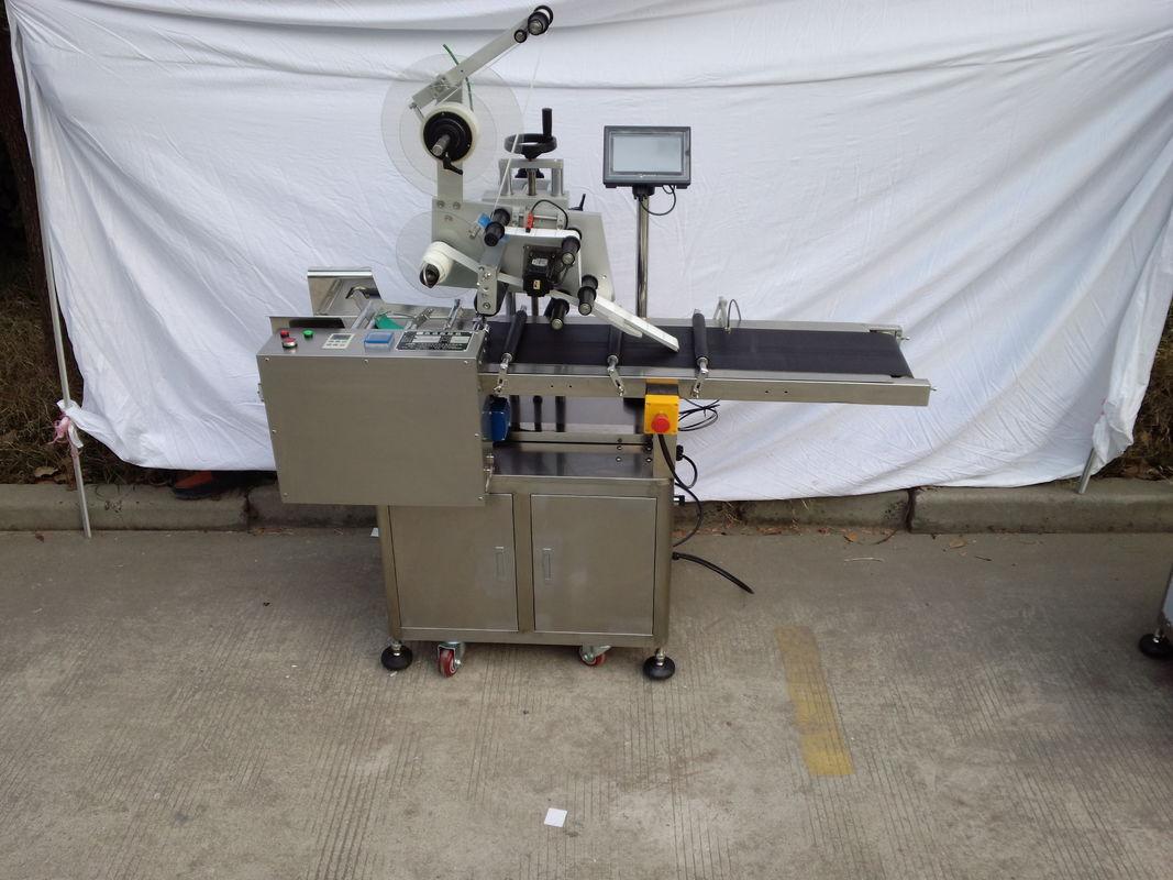Servo motor za nanašanje nalepk z etiketo iz papirja v ročni torbi