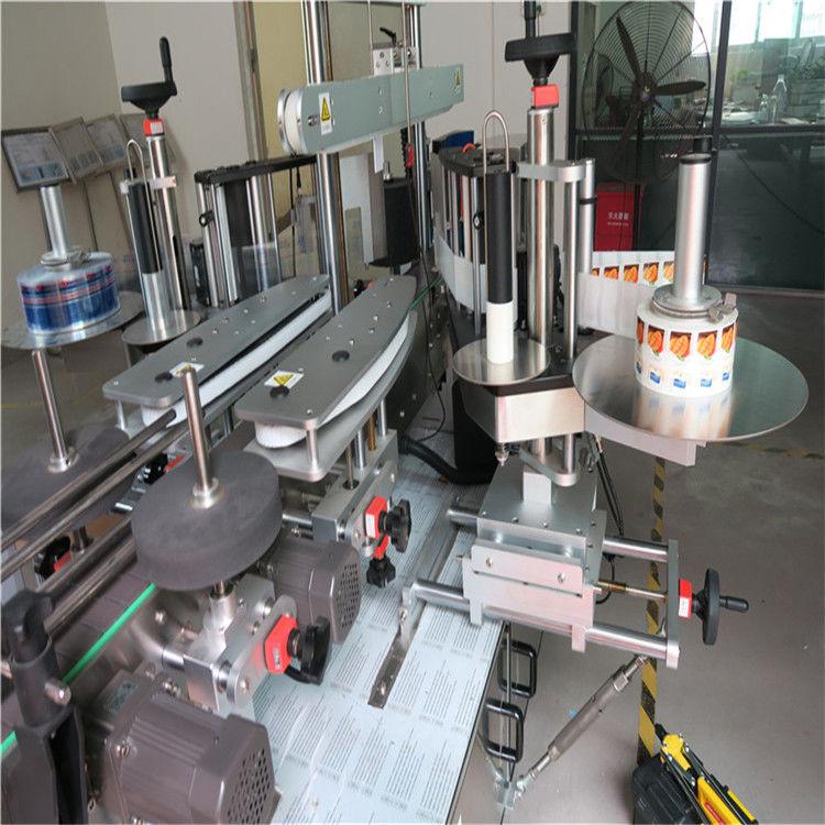 Stroj za nanašanje etiket z enojno / dvostransko okroglo steklenico